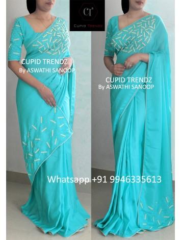 Aqua green crepe silk saree with off-white beads work