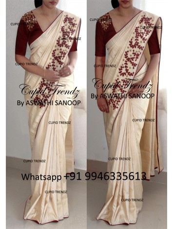 Cream color semi silk saree with maroon handwork