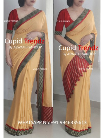 Golden crepe saree with brocade and maroon border