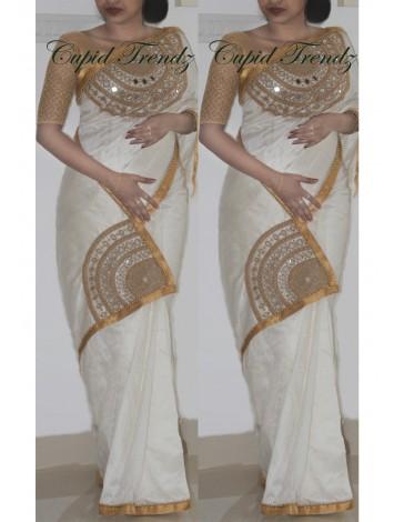 Off-white rawsilk saree with antique golden and mirror work