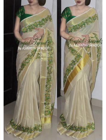 Tissue kerala saree with parrot green fabric print